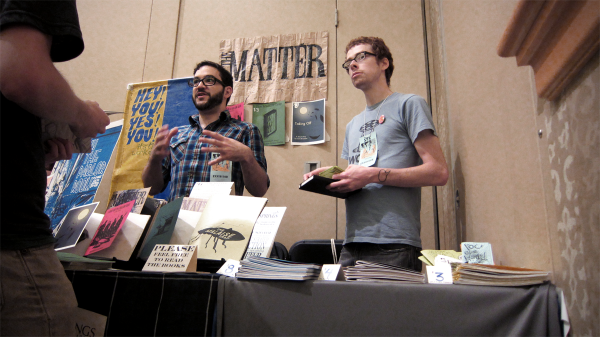matthew ocasio and neil brideau sell some zines